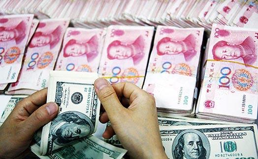 Народный банк Китая укрепил курс юаня к доллару на 0,45%